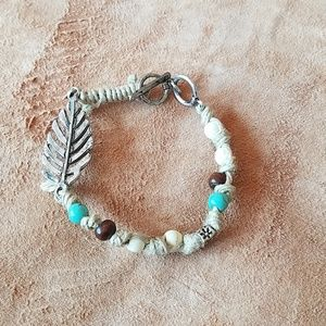 Jute beaded bracelet with silver feather